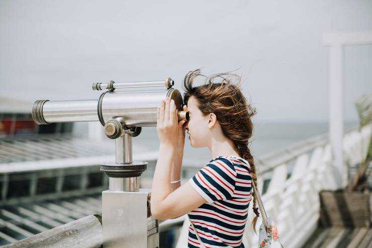 woman spying with a telescope